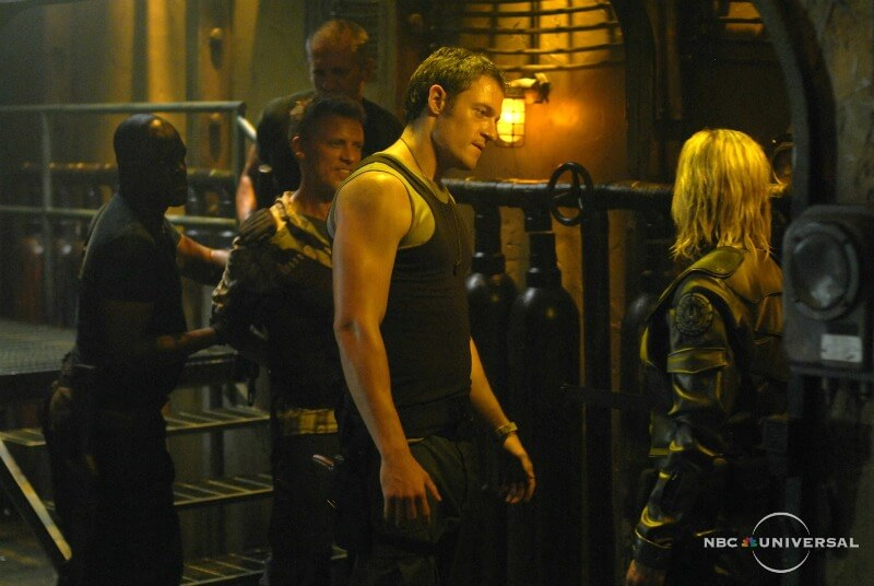 BATTLESTAR GALACTICA The Road Less Traveled 4x05 Tahmoh Penikett as Helo Katee Sackoff as Starbuck Syfy